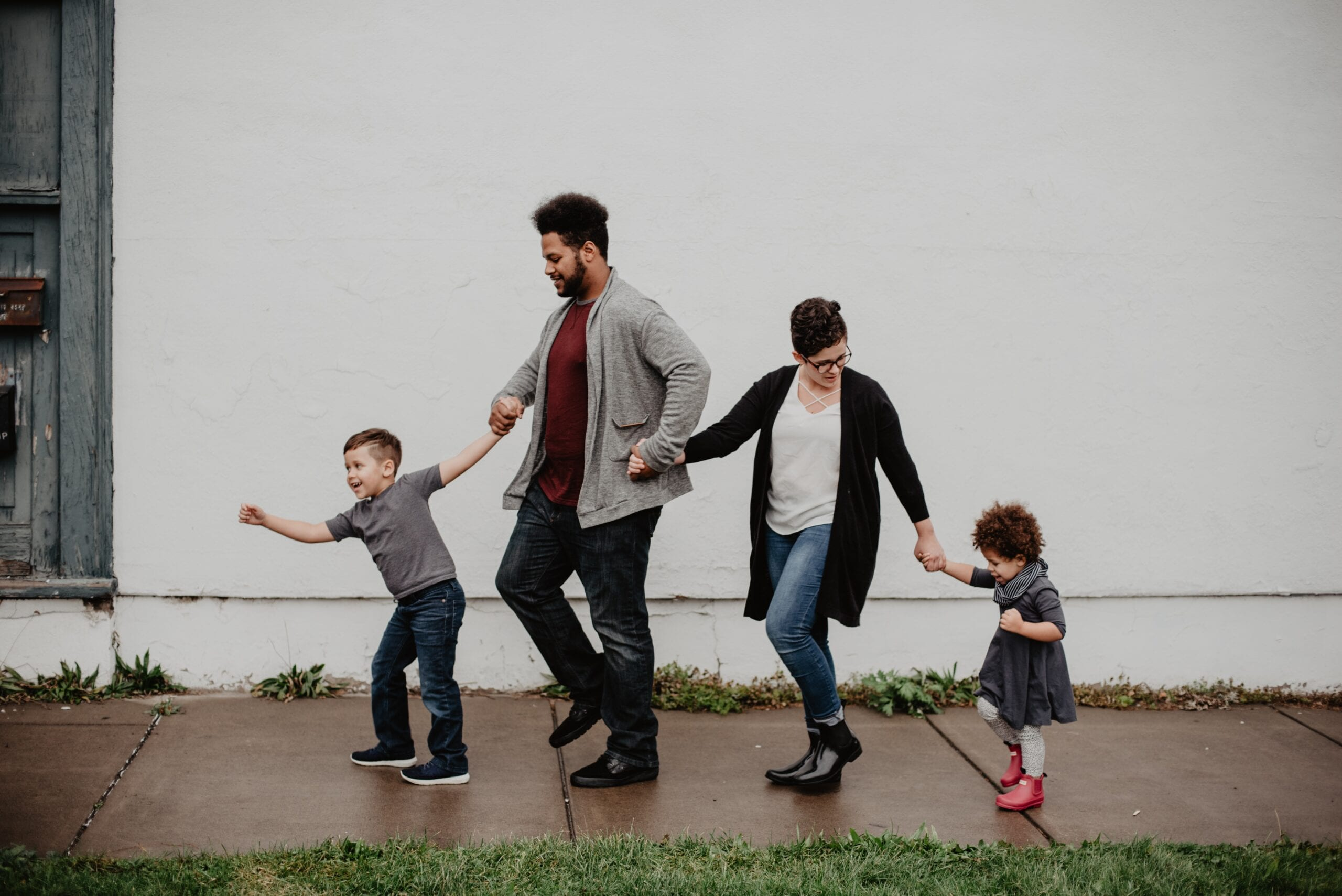 a family of people walking happily